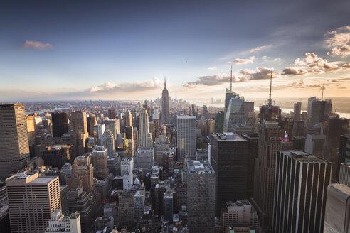 USA, New York City, Manhattan skyline at sunset - STCF00264