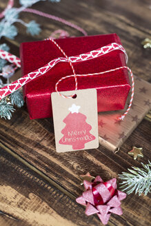 Christmas decoration and wrapped presents on wood - SARF02947
