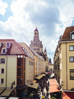 Germany, Dresden, view to dome of Dresden Frauenkirche with facades and shopping street in the foreground - KRP01851