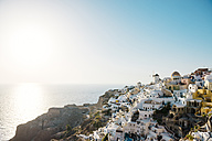 Greece, Santorini, Oia, view to the village at evening twilight - GEMF01085
