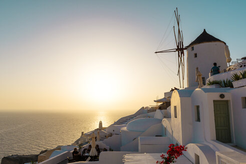 Greece, Santorini, Oia, houses and wind mill at sunset - GEM01088