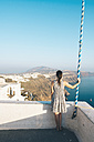 Greece, Santorini, Thira, woman looking at view - GEMF01100