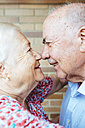 Senior couple rubbing noses - GEMF01106
