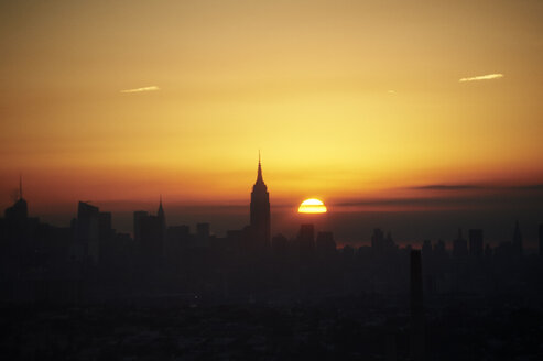 USA, New York State, New York City, Cityscape with Empire State building at sunrise - BCDF00201