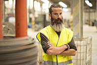 Portrait of confident worker in factory hall - JASF01210