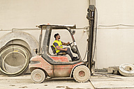 Worker driving forklift - JASF01228