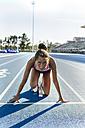 Female runner starting at race - MGOF02474