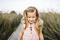 Portrait of smiling little girl in nature - JRFF00875