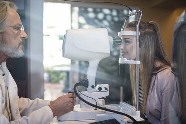 Young woman doing eye test at the optometrist's - ZEF10546