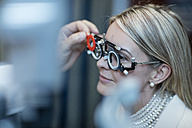 Optometrist adjusting test frame for patient - ZEF10567