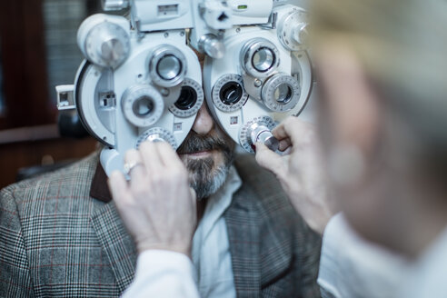 Female optometrist doing eye test with patient - ZEF10573