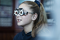 Girl doing eye test at optometrist - ZEF10588