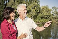 Happy senior couple at a lake - ONF01026