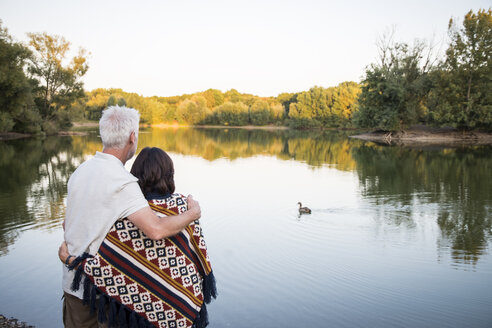 Senior couple at a lake looking at duck - ONF01047