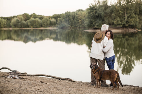 Senior couple with dog at a lake - ONF01050