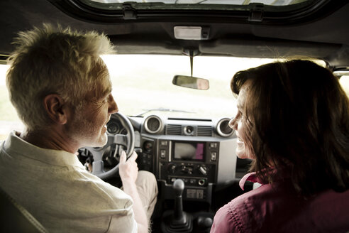 Senior couple on a trip in a cross country vehicle - ONF01056