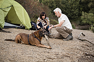 Senior couple with dog at a tent - ONF01092
