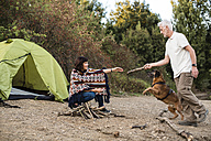 Senior couple with dog at a tent - ONF01095