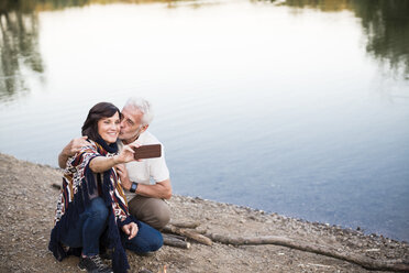 Senior couple at a lake taking a selfie - ONF01098