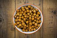 Bowl of roasted chickpeas on wood - LVF05394
