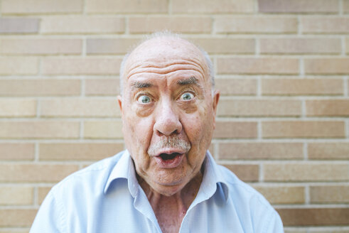 Portrait of senior man pulling funny faces - GEMF01124