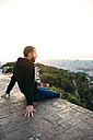 Spain, Barcelona, Man enjoying view over city - GEMF01127