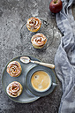 Filo pastry apple cakes in rose shape with cup of coffee - SARF02974