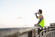 Spain, Mallorca, Jogger with water bottle - DIGF01357