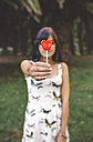 Young woman holding heart-shaped lollipop - DAPF00394
