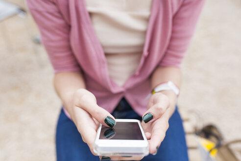 Woman's thumb typing on display of  smartphone - BOYF00586