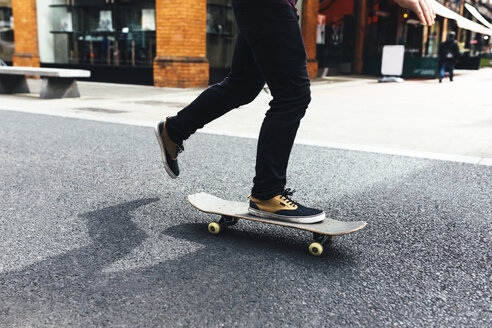 Young skateboarder on the street, partial view - BOYF00619