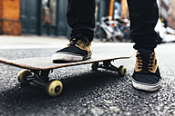 Young skateboarder  on the street, partial view - BOYF00622