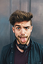 Portrait of young man sticking out tongue - BOYF00628
