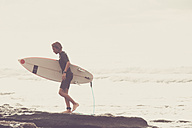 Tenerife, young surfer at the beach - SIPF00921