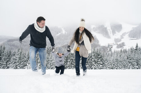 Happy family in winter landscape - HAPF00958