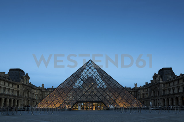 France, Paris, Louvre, glass pyramide in courtyard, blue hour - FC01096