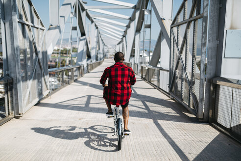 Man riding bicycle on a bridge - JRFF00970