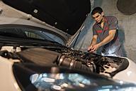 Mechanic repairing car in a garage - JASF01239