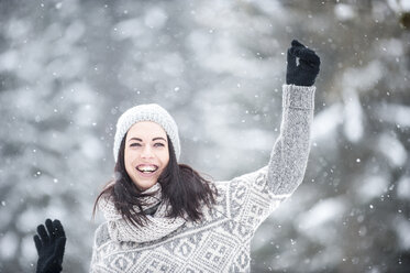 Young woman having fun in snow - HHF05418