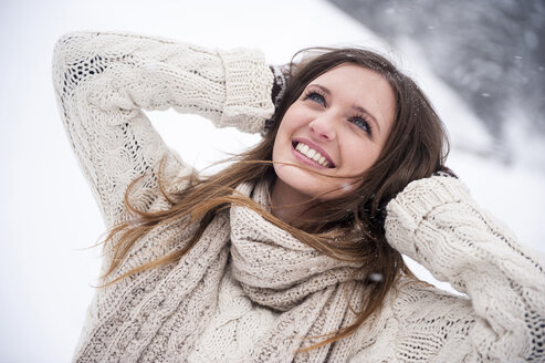 Young woman having fun in snow - HHF05421