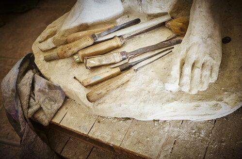 Chisels on base of stone sculpture n sculptor's workshop - DIK00228