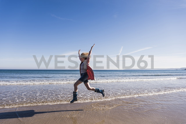 France, Crozon peninsula, teenage girl jumping for joy on the beach - UUF08657
