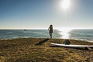 Back view of teenage girl enjoying view at seaside - UUF08742