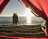 Young couple in love camping at seaside - UUF08784