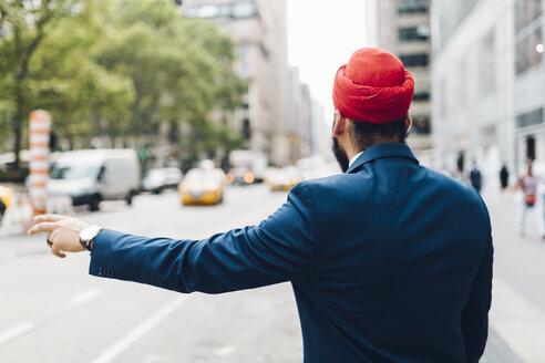 Indian businessman hailing a taxi in Manhattan - GIOF01522