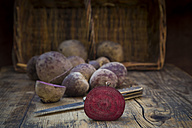 Sliced beetroot on dark wood - LVF05474