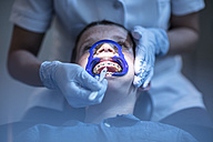 Boy in dental surgery receiving orthodontic treatment - ZEF10644