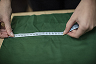 Close-up of woman working with measuring tape in tailor shop - ZEF10683