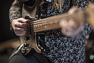 Close-up of woman playing electric guitar - ZEF10739