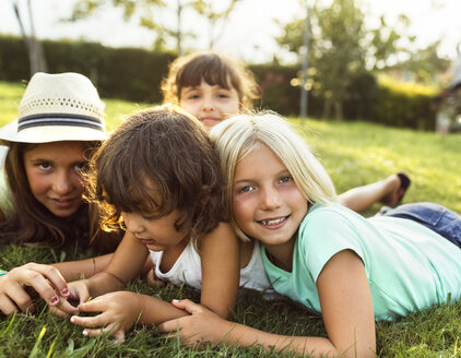 Four little girls playing together on a meadow - MGOF02532
